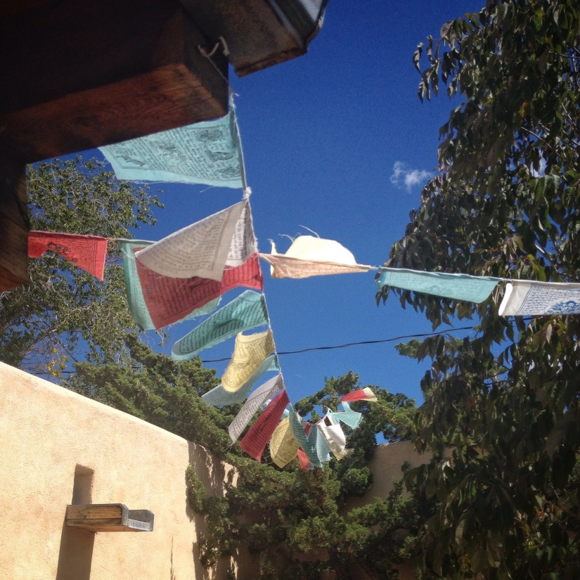 prayer-flags-outside-ark-bookstore-santa-fe_29596647122_o